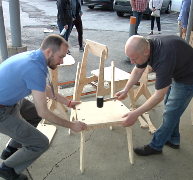 Photo of Shaun Mueller on the left and Steve Schaer on the right, assisting with building a table at