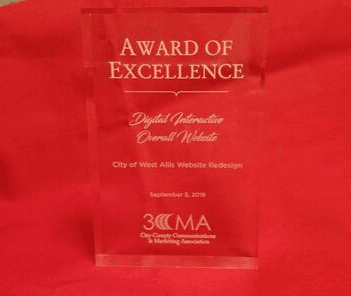 Photograph of clear glass award on red background