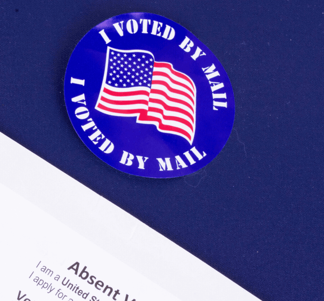 Vote by Mail sticker on blue background