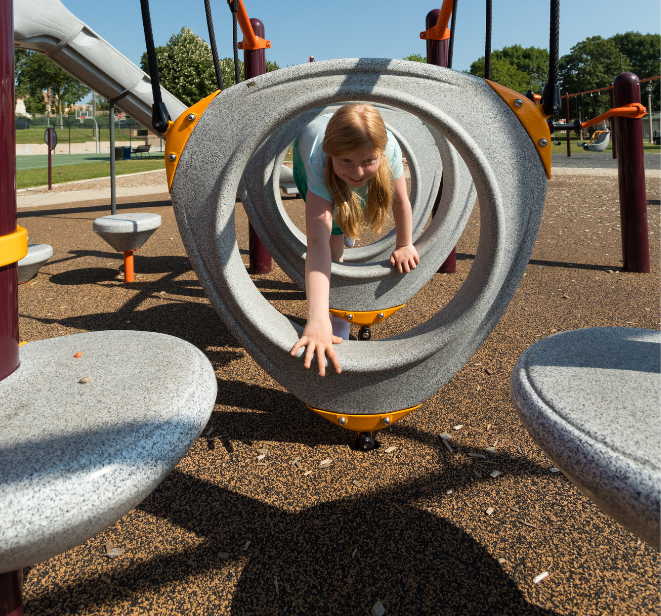 Photograph of happy child playing on equipment at Liberty Heights Park