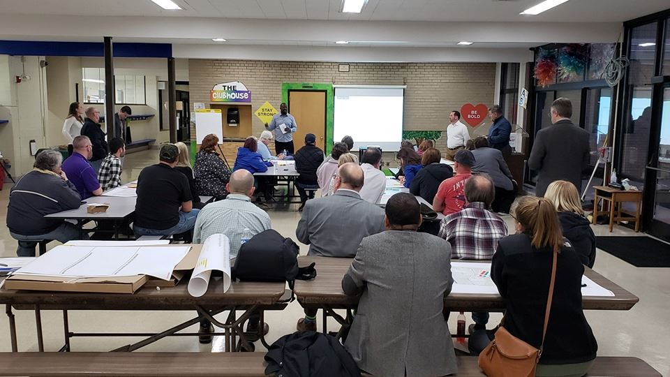 Photograph from the back of meeting room at the first Highway 100 community meeting held on October